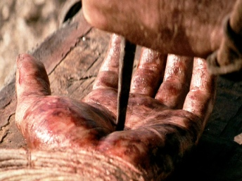 "The movie ""The Passion of the Christ"", directed by Mel Gibson. Seen here, the left hand of James Caviezel as Jesus, during crucifixion. Initial theatrical release February 25, 2004. Screen capture. © 2004 Icon Distribution, Inc. Credit: © 2004 Icon Distribution / Flickr / Courtesy Pikturz. Image intended only for use to help promote the film, in an editorial, non-commercial context."